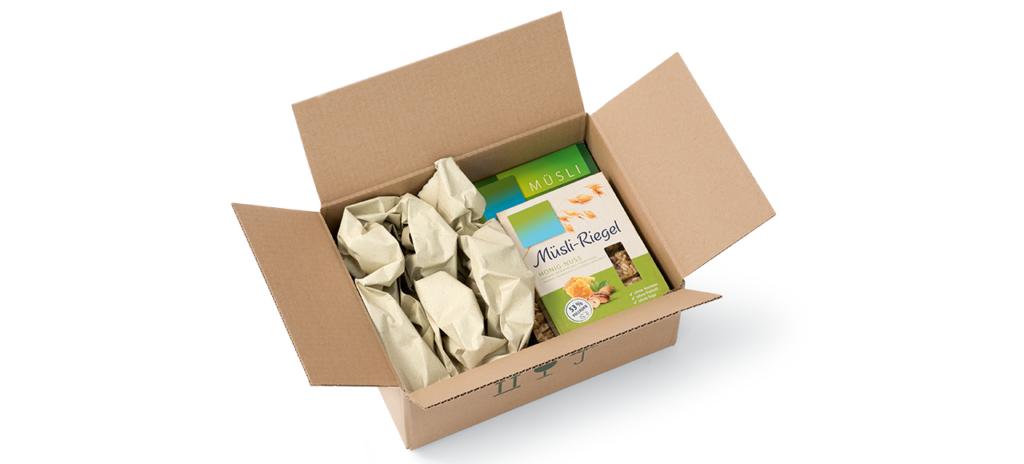 colis de boite de céréale dans un emballage carton avec papier de calage